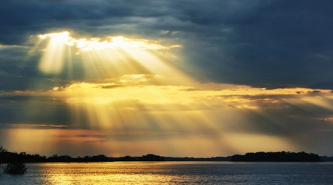 A heaven rays of sunshine on river